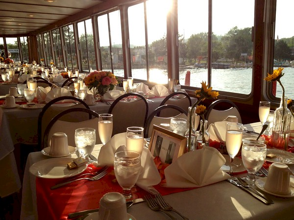 White table cloth dinner tables on Dinner Cruise